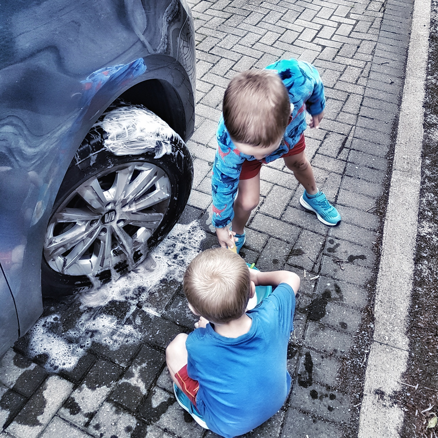 washing the car with kids